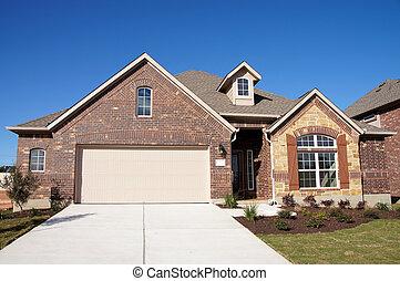 Cute house brick stone blue sky - Cute house with brick and...