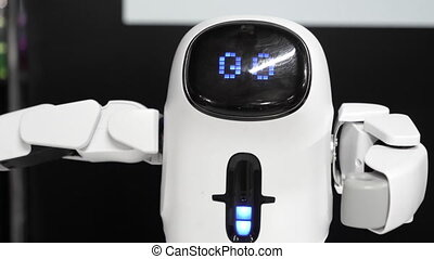 Cute humanoid robot making a move showing how strong he is.