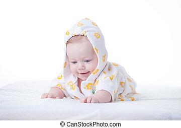 Cute infant girl in hood