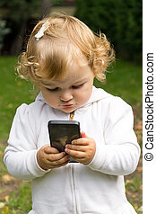 Cute infant with cellular - Cute baby girl with new mobile...