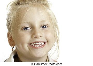 Cute innocent child laughs happy in camera