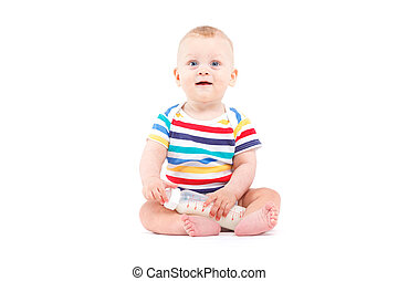cute joyful baby boy in colorful shirt hold milk bottle