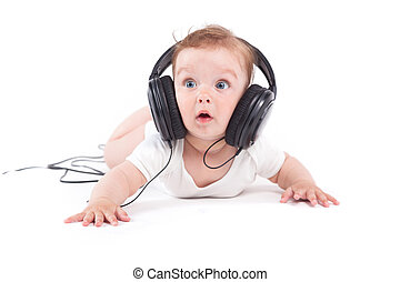 cute joyful baby boy in white shirt and headphones on head