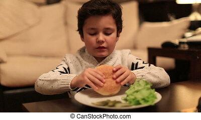 cute kid bite delicious hamburger