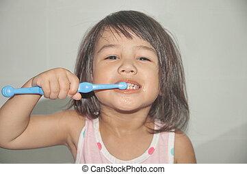 cute kid brushing teeth