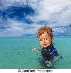 cute kid in wetsuit