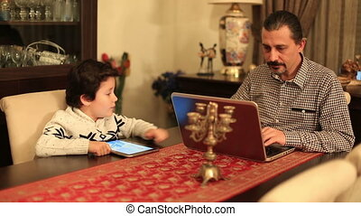 cute kid needs to help from his father at home