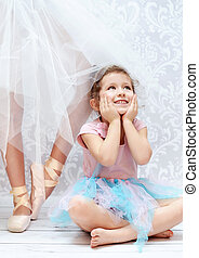 Cute kid next to the ballet dancer sister