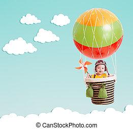 cute kid on hot air balloon in the blue sky - cheerful kid...