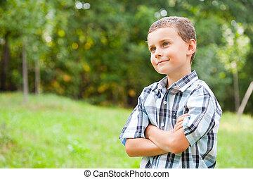 Cute kid outdoors in a grass field