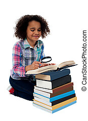 Cute kid reading book with magnifying glass