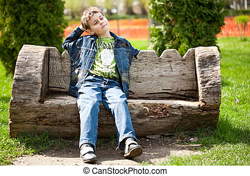Cute kid sitting on bench