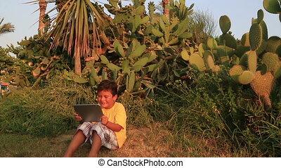 Cute kid using digital tablet
