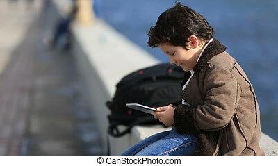 cute kid using tablet computer