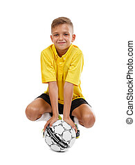Cute kid with a soccer ball isolated on a white background. School football. Sports equipment. Active sports concept.