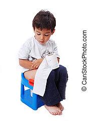 Cute kid with toilet paper on toilet - Cute kid is sitting...