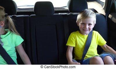 cute kids going in car