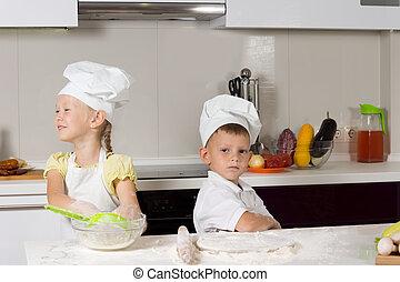 Cute Kids in Chefs Attire in Kitchen