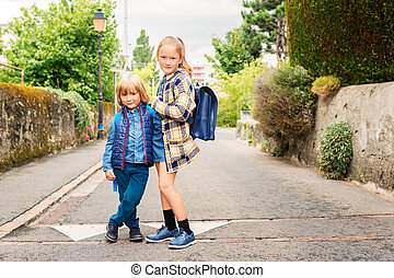 Two Kids Walking To School Two Elementary Age Kids With Backpacks