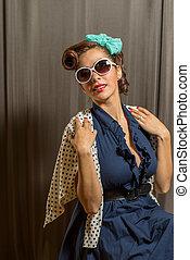 Cute latina female in polka dotted sweater