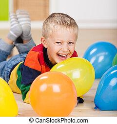 Cute laughing birthday boy