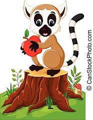 Cute lemur standing on tree stump