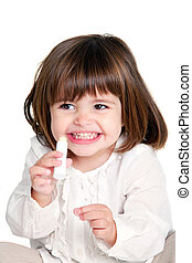 Portrait of cute little girl holding lip balm. Isolated on white background.