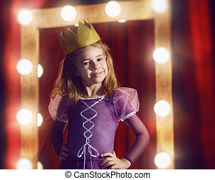 Cute little actress. Child girl in Princess costume on the ...