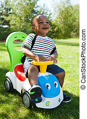 Cute Little african american baby boy playing