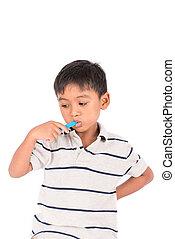 Cute little asian boy brush teeth