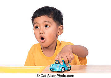 Cute little asian boy child kid preschooler playing with blue car toy
