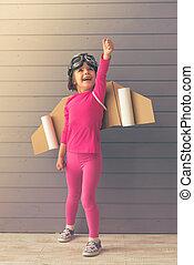 Cute little astronaut - Cute little girl dressed like a...