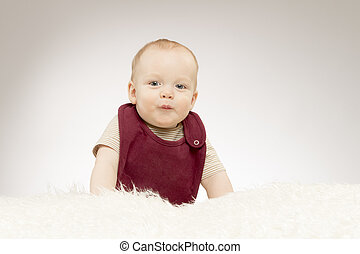 Cute little baby boy with a duck face, lovely baby portrait