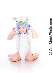 Cute little baby crawling in a owl hat