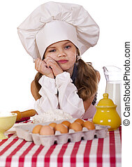 Cute little baby dressed as a cook