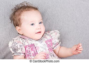 Cute little baby girl in a summer dress