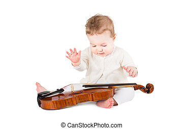cute little baby girl playing with a violin