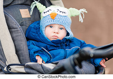 Cute little baby in a stroller