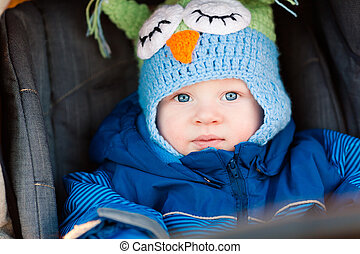 Cute little baby in a stroller outdoor