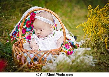 cute little baby in basket