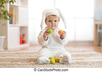 Cute little baby in bunny costume playing at home - Cute...