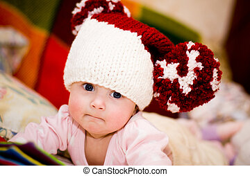 cute little baby in wool hat with big pompoms