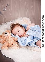 cute little baby todler infant lying on blanket