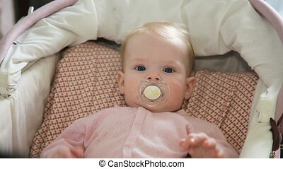 Cute little baby with pacifier.