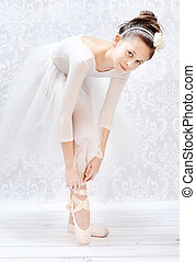 Cute little ballerina before performance