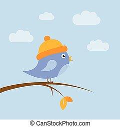 cute little bird sitting on a branch at autumn
