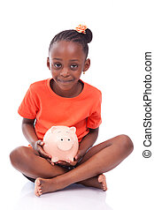 Cute little black girl holding a smiling piggy bank, isolated on white background - African children