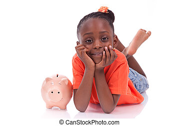 Cute little black girl with a smiling piggy bank, isolated on white background - African children