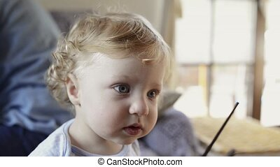 Cute little boy at home with drumsticks. - Cute little...