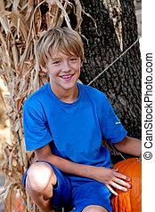 Cute little boy at pumpkin patch